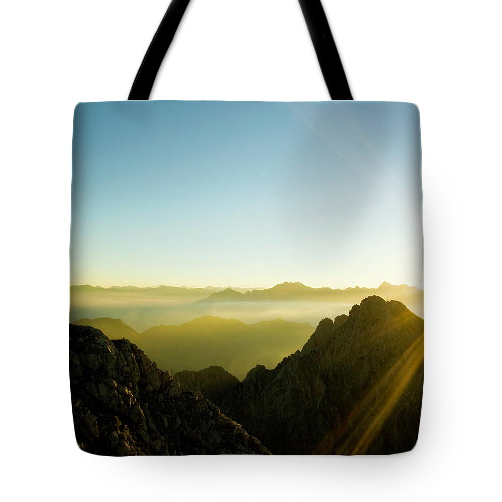 Dawn Tote Bag featuring the photograph Man by Lopurice