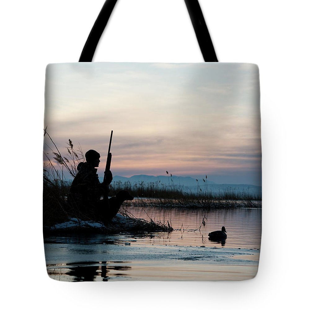Rifle Tote Bag featuring the photograph Man Out Hunting by Rubberball Productions