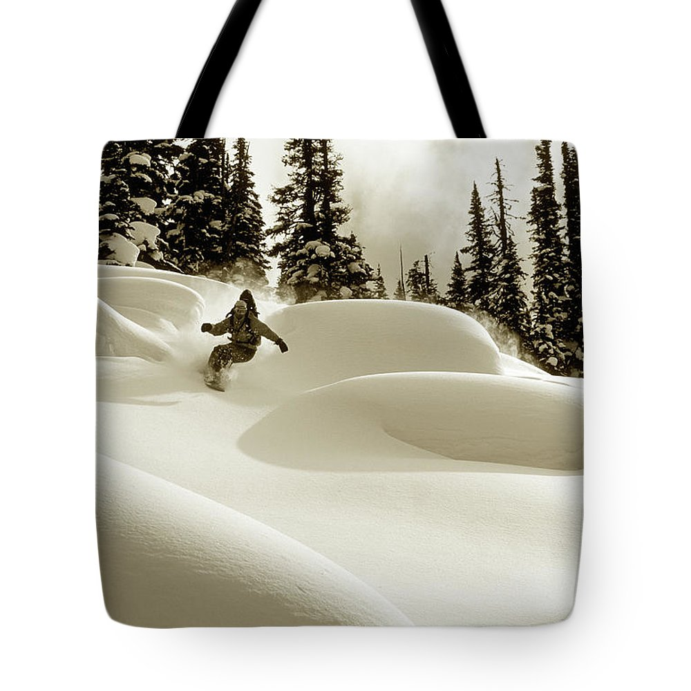 One Man Only Tote Bag featuring the photograph Man Snowboarding B&w Sepia Tone by Per Breiehagen