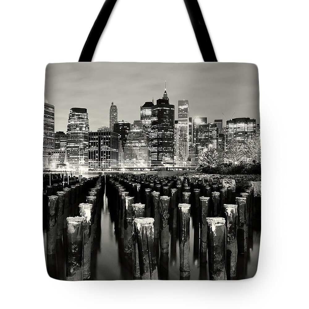 Wooden Post Tote Bag featuring the photograph Manhattan At Night by Shobeir Ansari