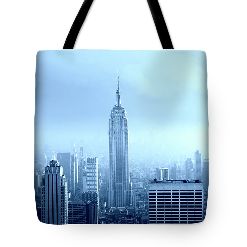 Lower Manhattan Tote Bag featuring the photograph Manhattan Skyline In The Fog, Nyc. Blue by Lisa-blue