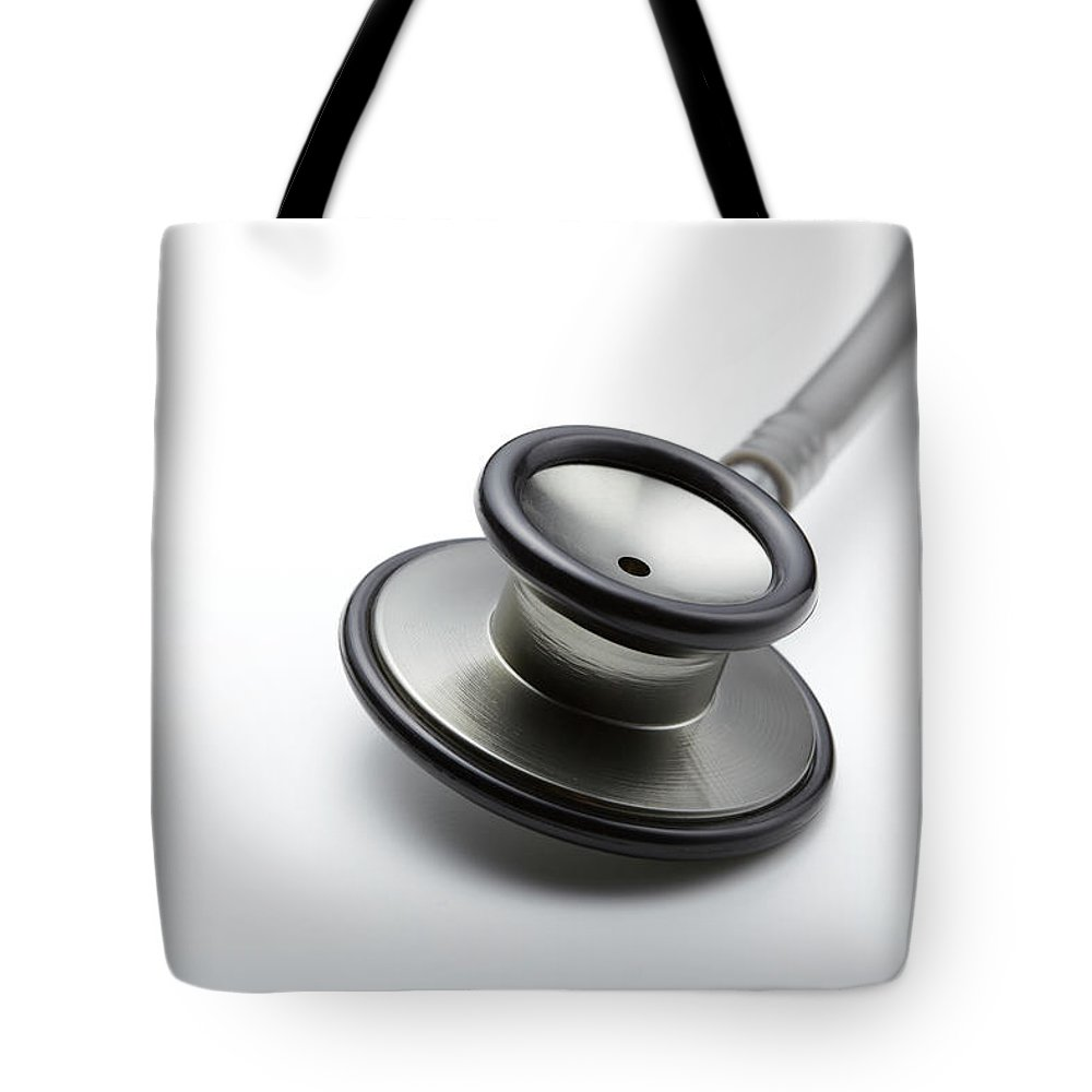 White Background Tote Bag featuring the photograph Medical by Yuji Kotani