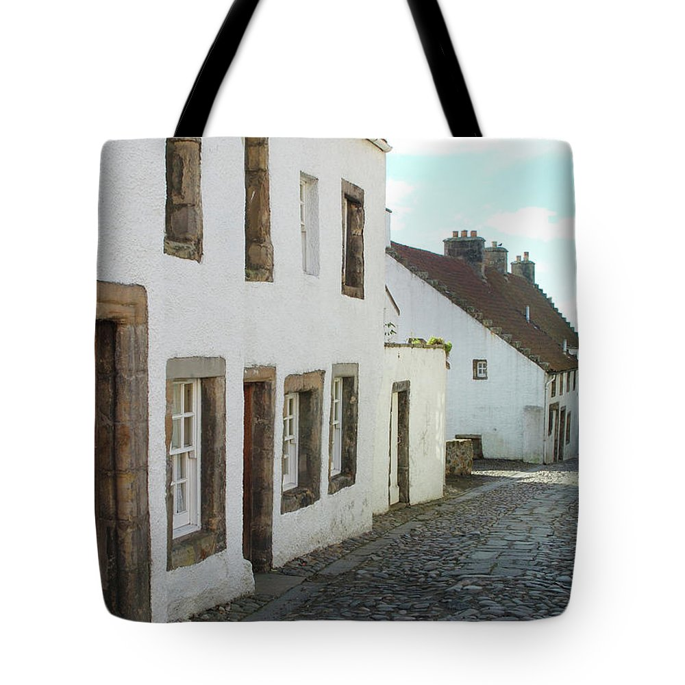 Cobbles Tote Bag featuring the photograph medieval cobbled street in Culross, fife by Victor Lord Denovan
