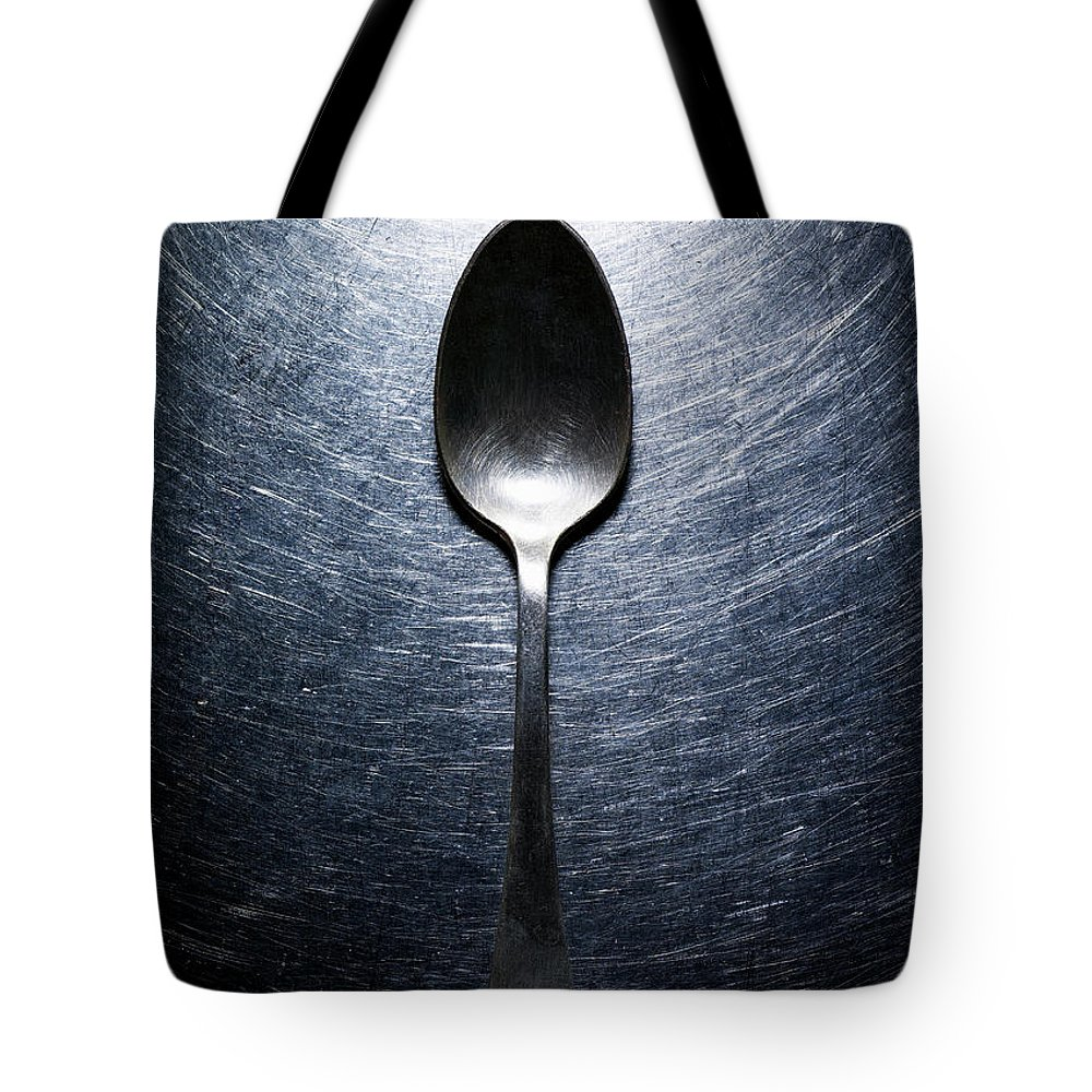 Spoon Tote Bag featuring the photograph Metal Spoon On Stainless Steel by Ballyscanlon