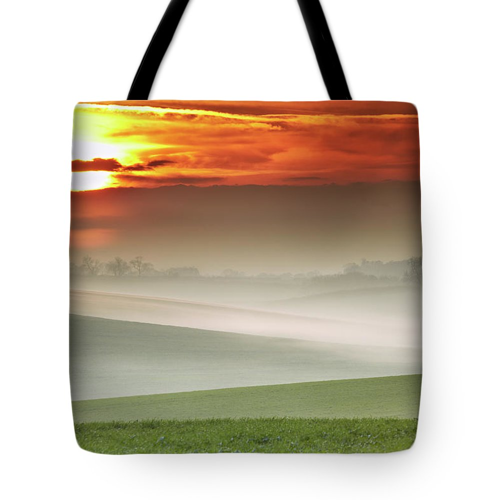 Tranquility Tote Bag featuring the photograph Mist Over Landscape Of Rolling Hills by Andy Freer