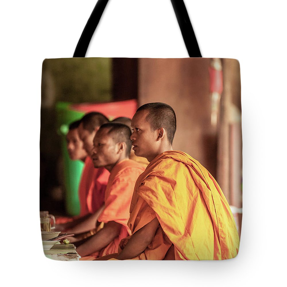 Young Men Tote Bag featuring the photograph Monks At Breakfast, Wat Monastery by Cultura Rm Exclusive/gary Latham