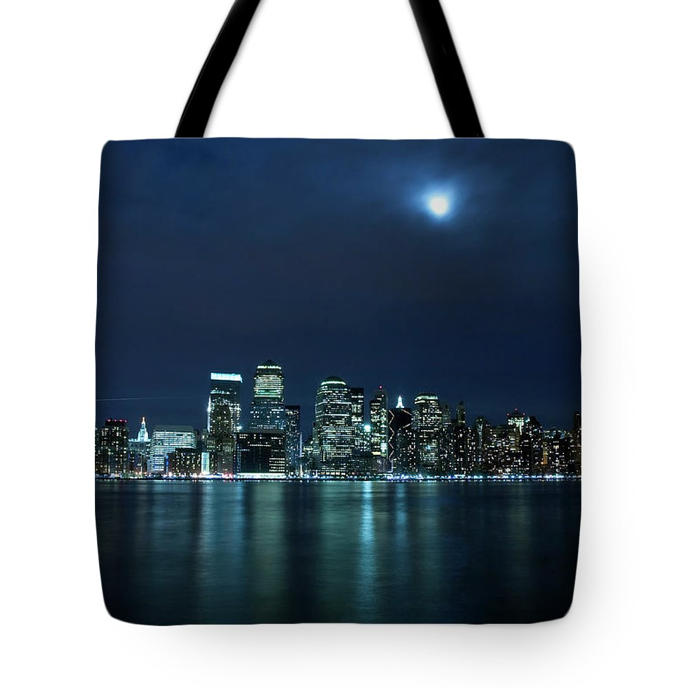 Lower Manhattan Tote Bag featuring the photograph Moon Light Over New York City by Brandonj74