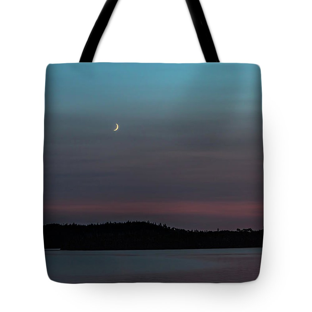 Crescent Moon Tote Bag featuring the photograph Moon Over Dog Lake by Joe Holley
