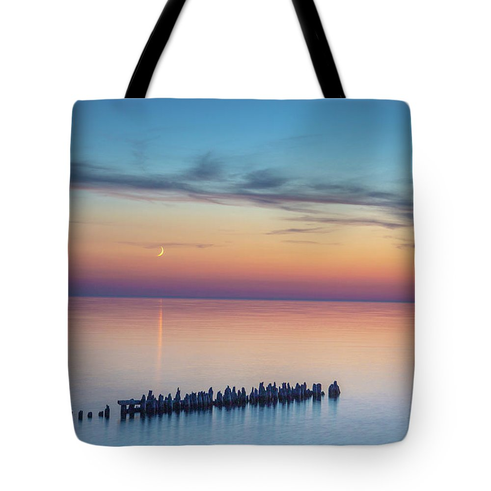 Moonset Tote Bag featuring the photograph Moonset On Lake Superior by Anthony Zeljeznjak