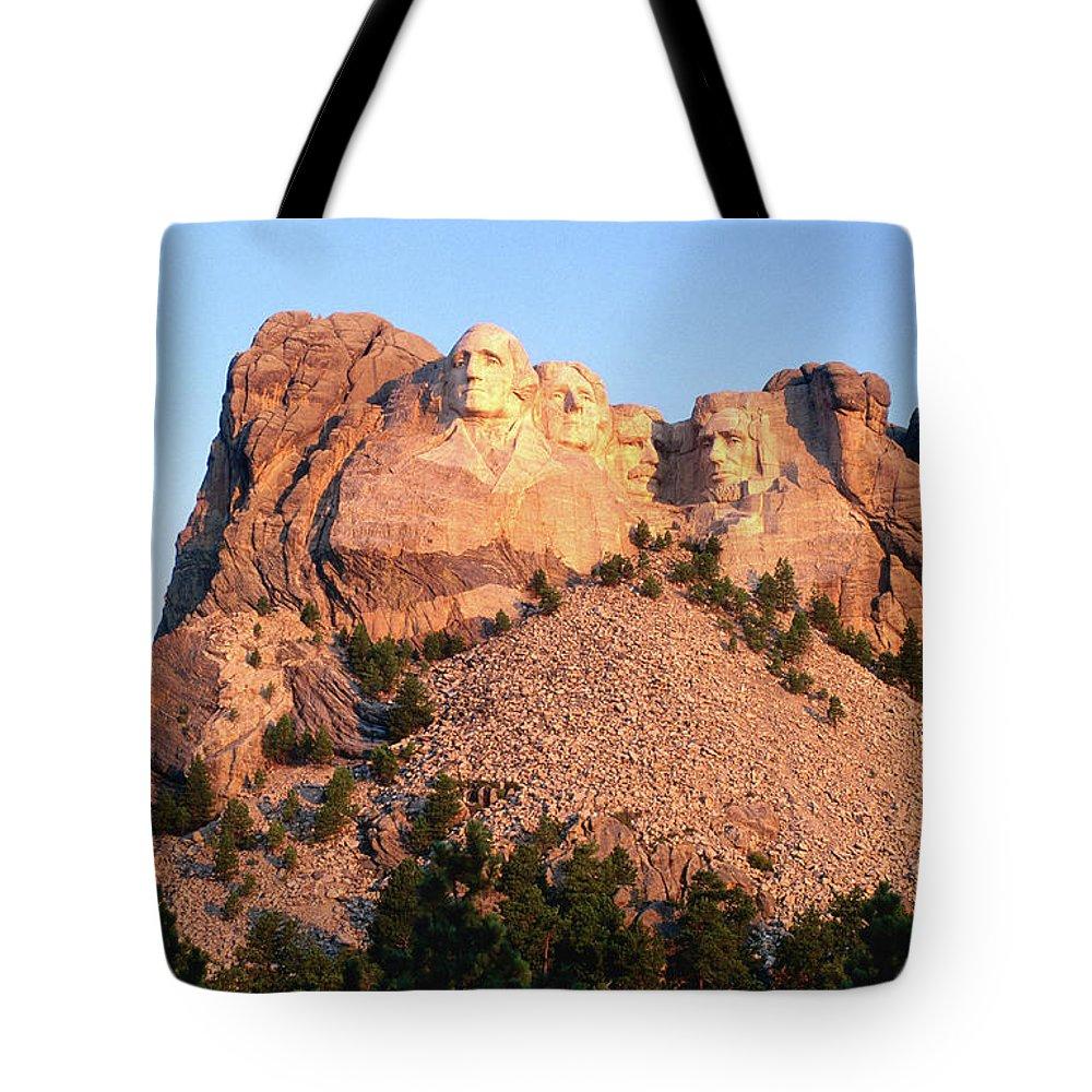 Mt Rushmore National Monument Tote Bag featuring the photograph Mt Rushmore Memorial Carvings by John Elk