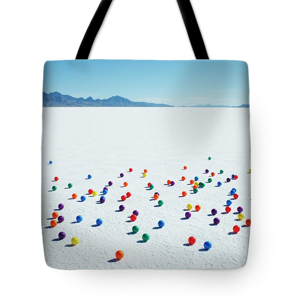Out Of Context Tote Bag featuring the photograph Multi-colored Balls On Salt Flats by Andy Ryan
