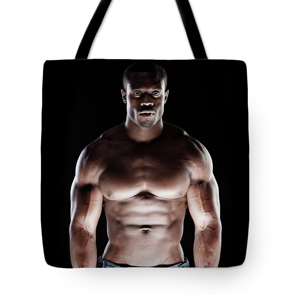 Young Men Tote Bag featuring the photograph Muscular Man by Pkline