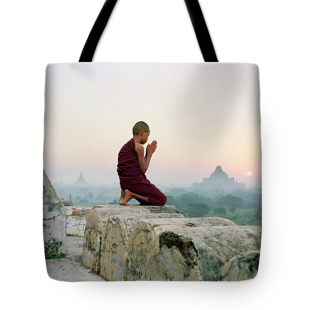 Child Tote Bag featuring the photograph Myanmar, Bagan, Buddhist Monk Praying by Martin Puddy