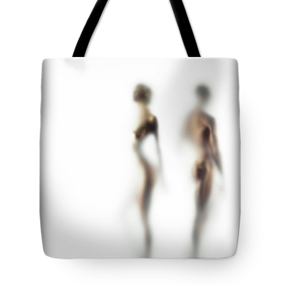 Young Men Tote Bag featuring the photograph Naked Young Woman And Man Defocussed by Symphonie