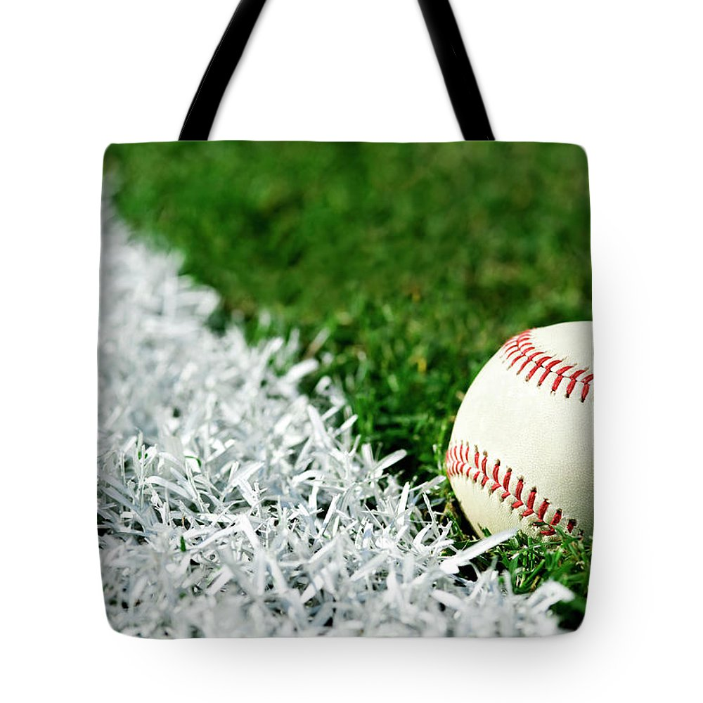 Grass Tote Bag featuring the photograph New Baseball Along Foul Line by Cmannphoto