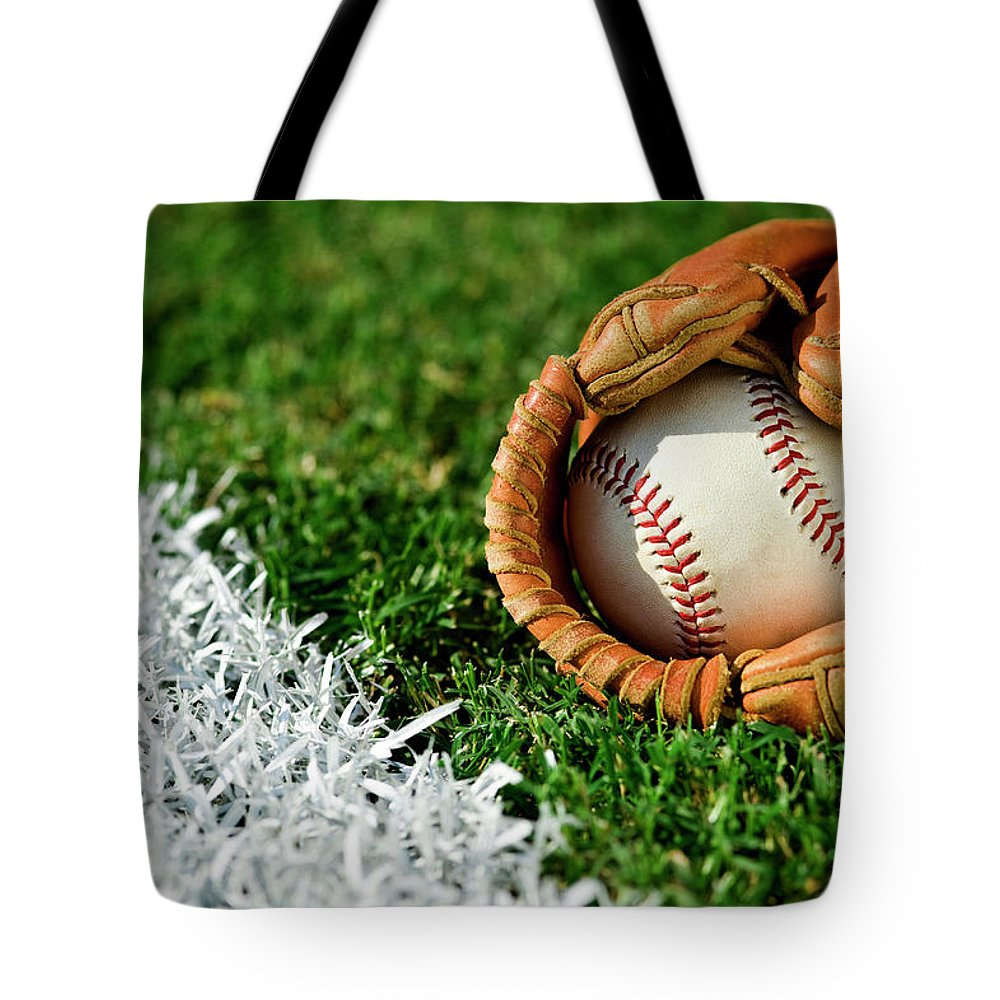 Grass Tote Bag featuring the photograph New Baseball In Glove Along Foul Line by Cmannphoto