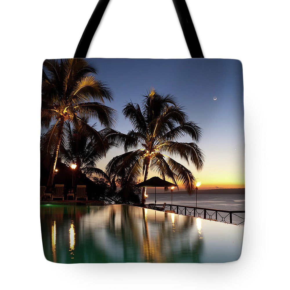 Swimming Pool Tote Bag featuring the photograph Nightfall At Iririki Island, Vanuatu by Holgs