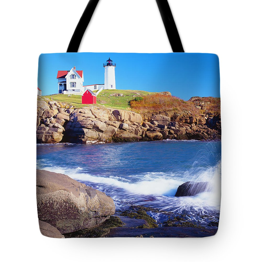 Water's Edge Tote Bag featuring the photograph Nubble Lighthouse And Coastine Of Maine by Ron thomas