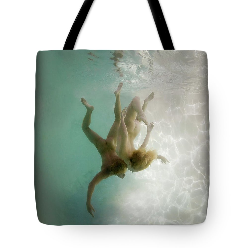 Young Men Tote Bag featuring the photograph Nude Man And Woman Underwater by Ed Freeman