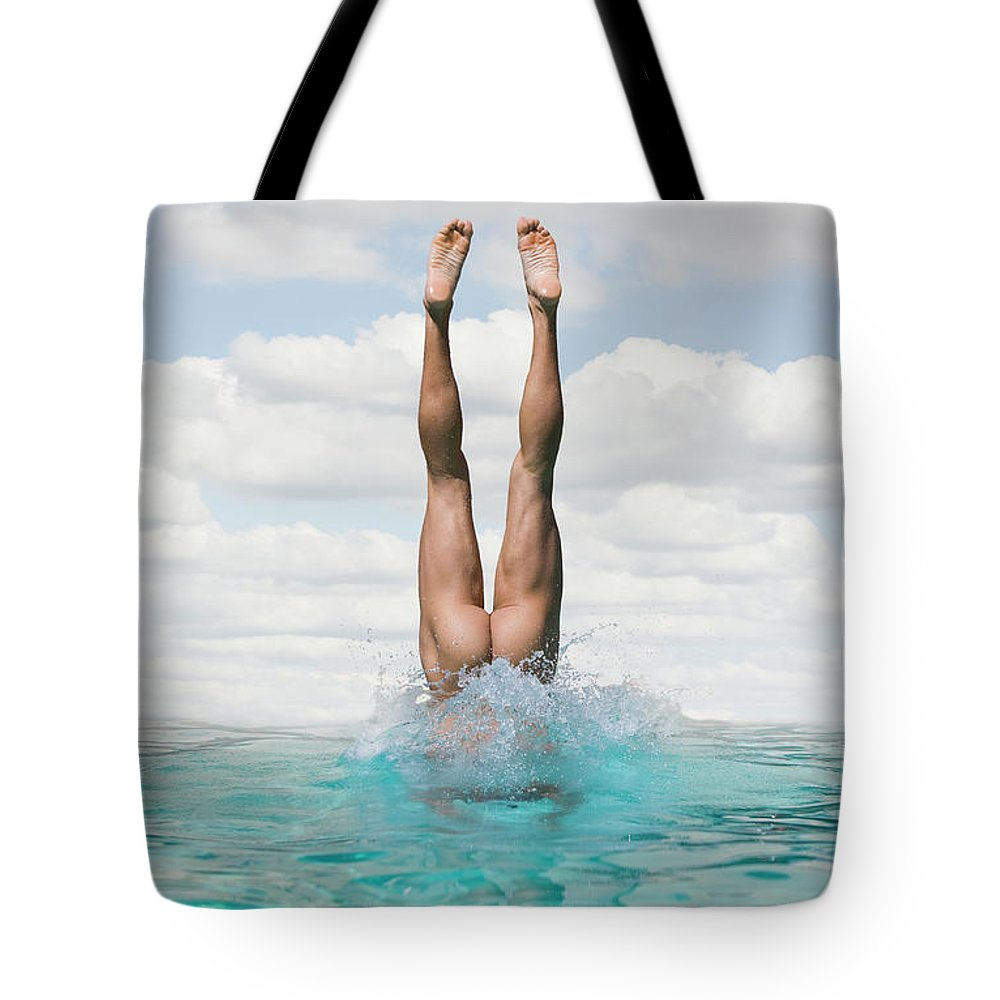 Diving Into Water Tote Bag featuring the photograph Nude Man Diving by Ed Freeman