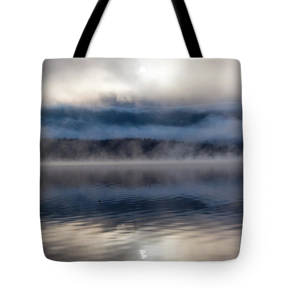 Grand Lake Area Tote Bag featuring the photograph Obscured By Clouds by Jason Bohl