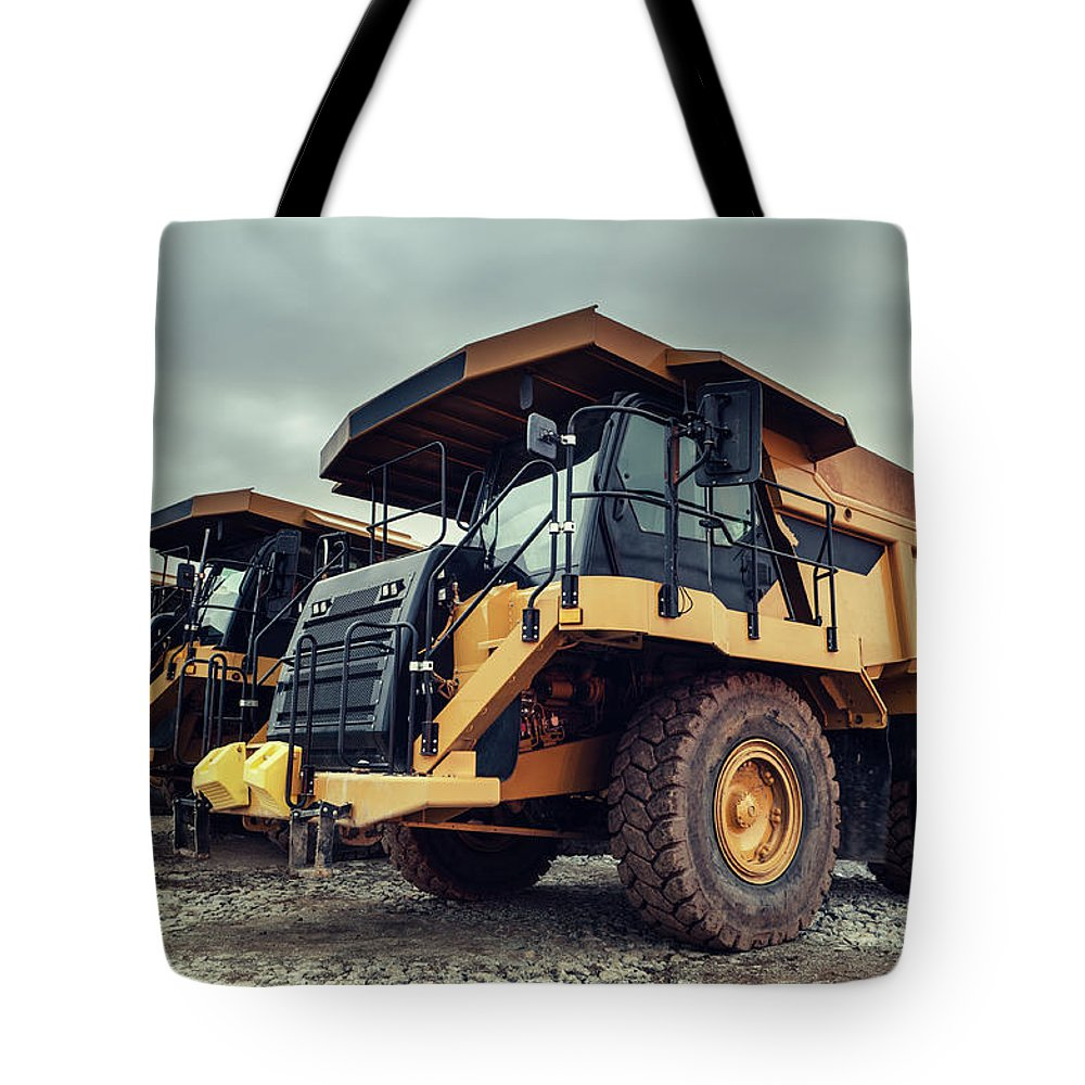 Construction Machinery Tote Bag featuring the photograph Off-highway Dump Trucks by Shaunl