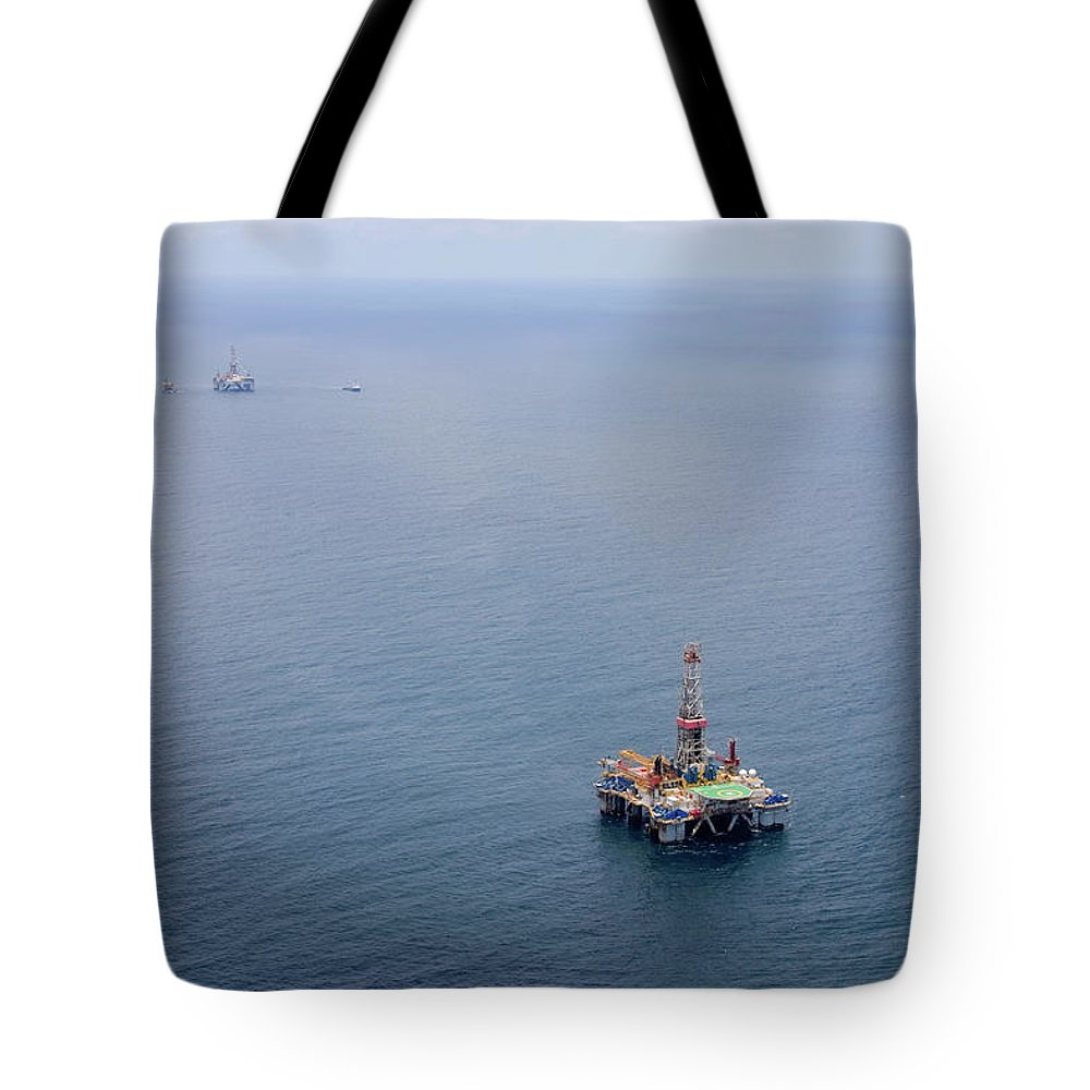 Convoy Tote Bag featuring the photograph Oil Rigs by Heliry