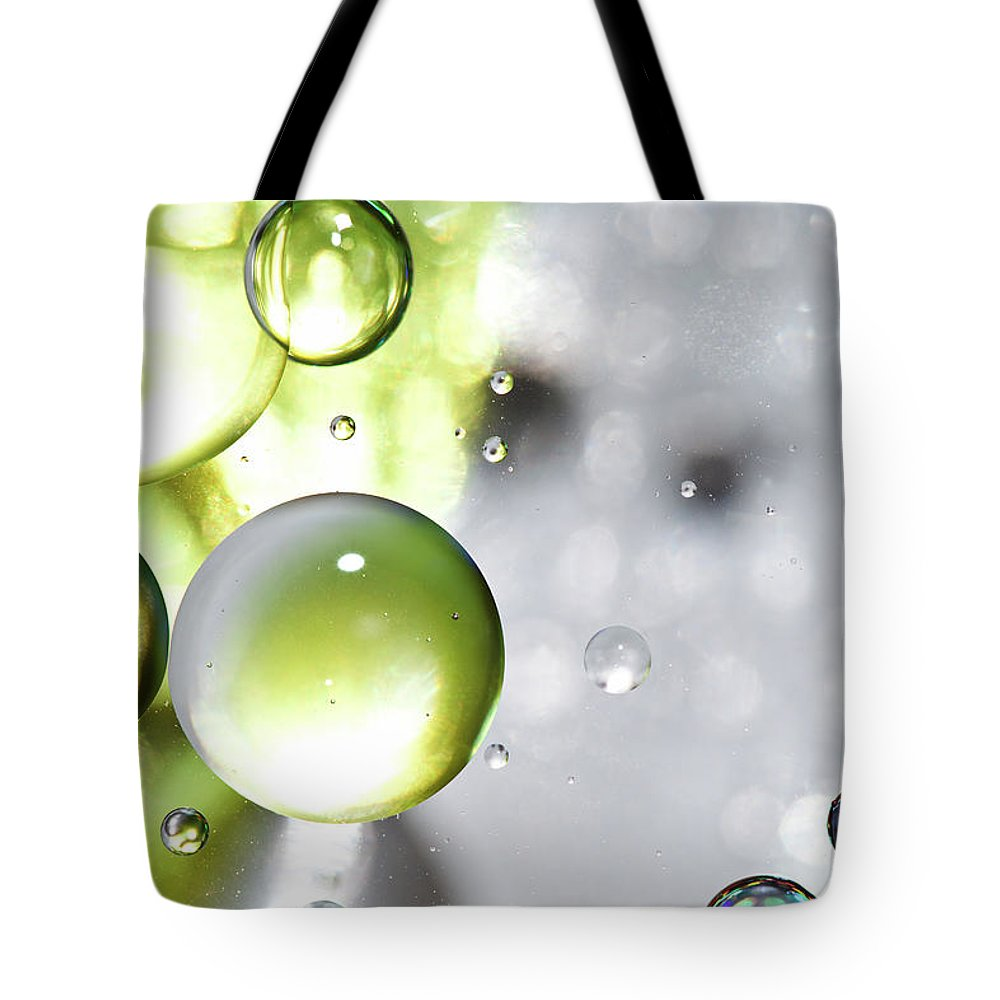 Mixing Tote Bag featuring the photograph Oil Spheres by Dovate
