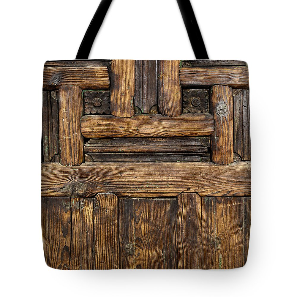 Arch Tote Bag featuring the photograph Old Wooden Door by Logosstock