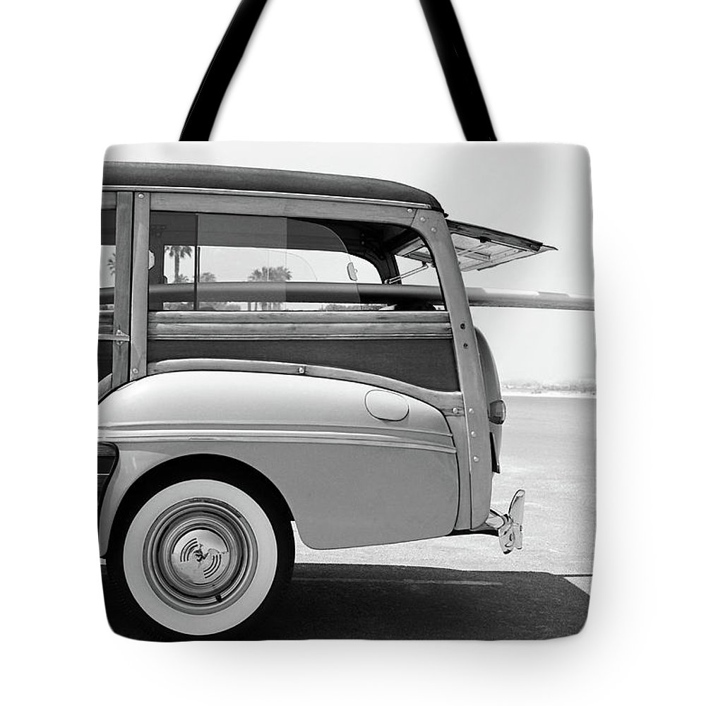 1950-1959 Tote Bag featuring the photograph Old Woodie Station Wagon With Surfboard by Skodonnell