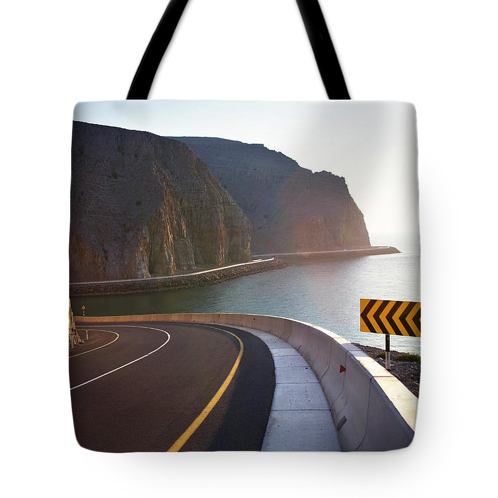 Curve Tote Bag featuring the photograph Oman, Khasab, Road Round Mountain By by Christian Adams