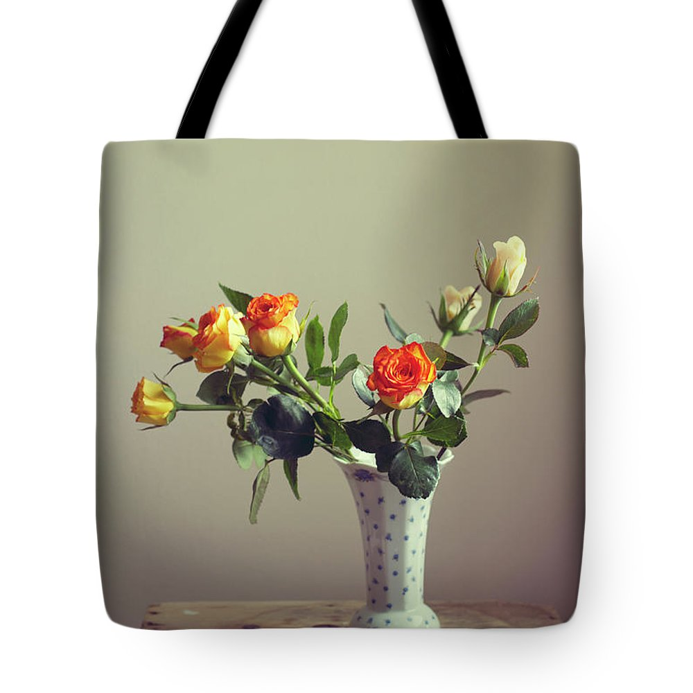Orange Color Tote Bag featuring the photograph Orange Roses In Vintage Vase by Copyright Anna Nemoy(xaomena)