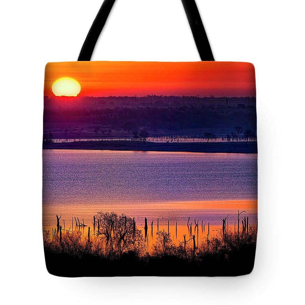 Scenics Tote Bag featuring the photograph Orange Sunrise On Benbrook Lake by Dean Fikar