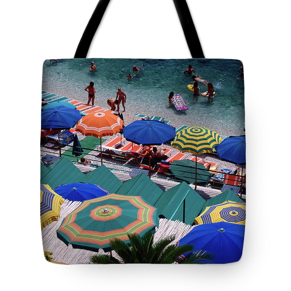 Shadow Tote Bag featuring the photograph Overhead Of Umbrellas At Private by Dallas Stribley