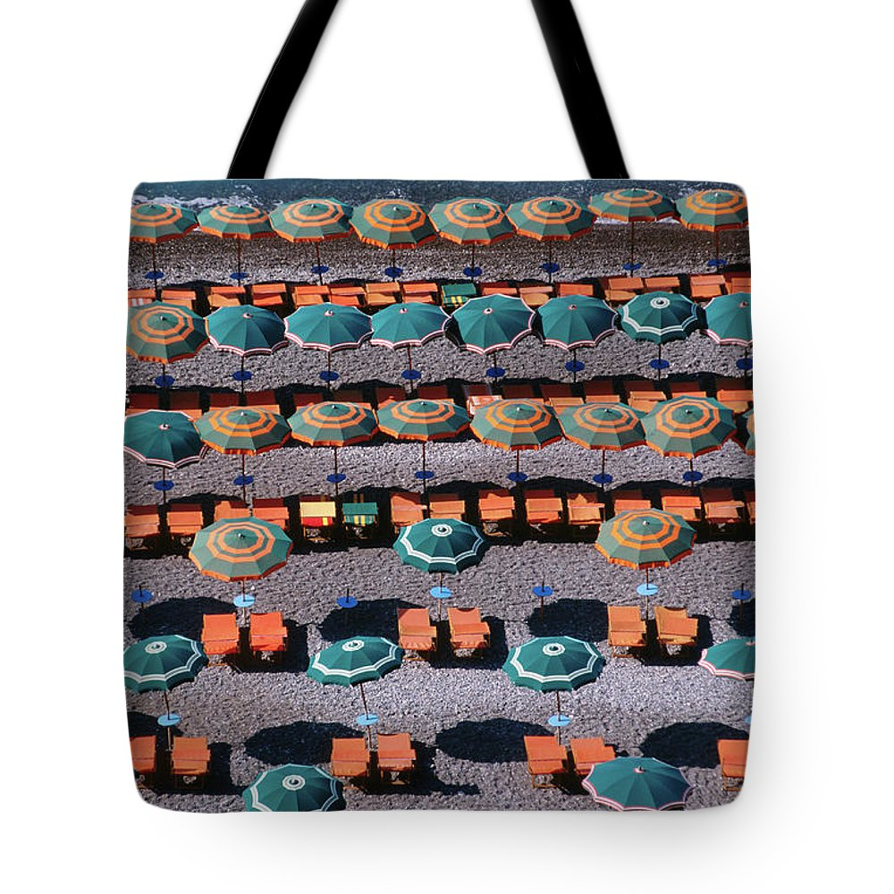 Shadow Tote Bag featuring the photograph Overhead Of Umbrellas, Deck Chairs On by Dallas Stribley