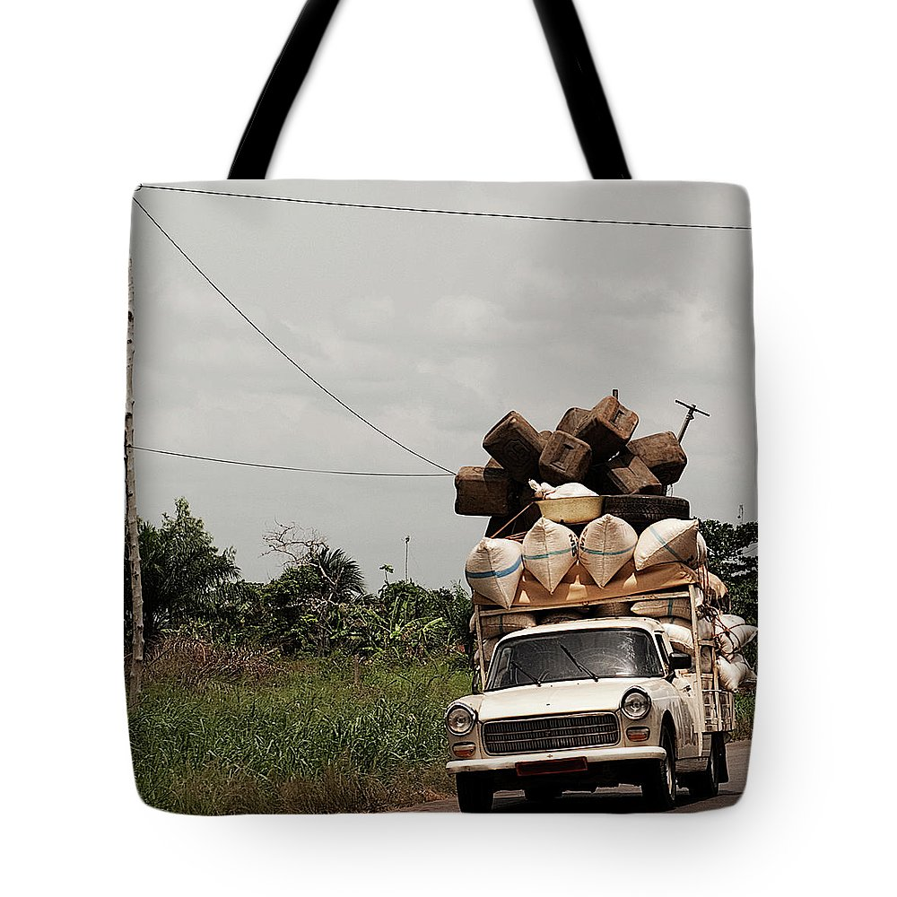 Transfer Print Tote Bag featuring the photograph Overloaded Car by Rodriguez Art Work