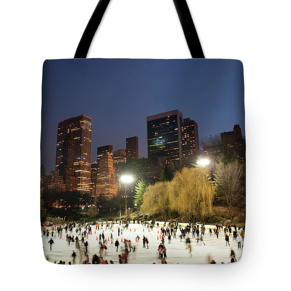 People Tote Bag featuring the photograph Panorama Of People Ice Skating In by Studiokiet