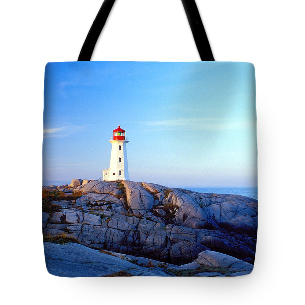 Water's Edge Tote Bag featuring the photograph Peggys Cove Lighthouse At Sunrise by Photorx