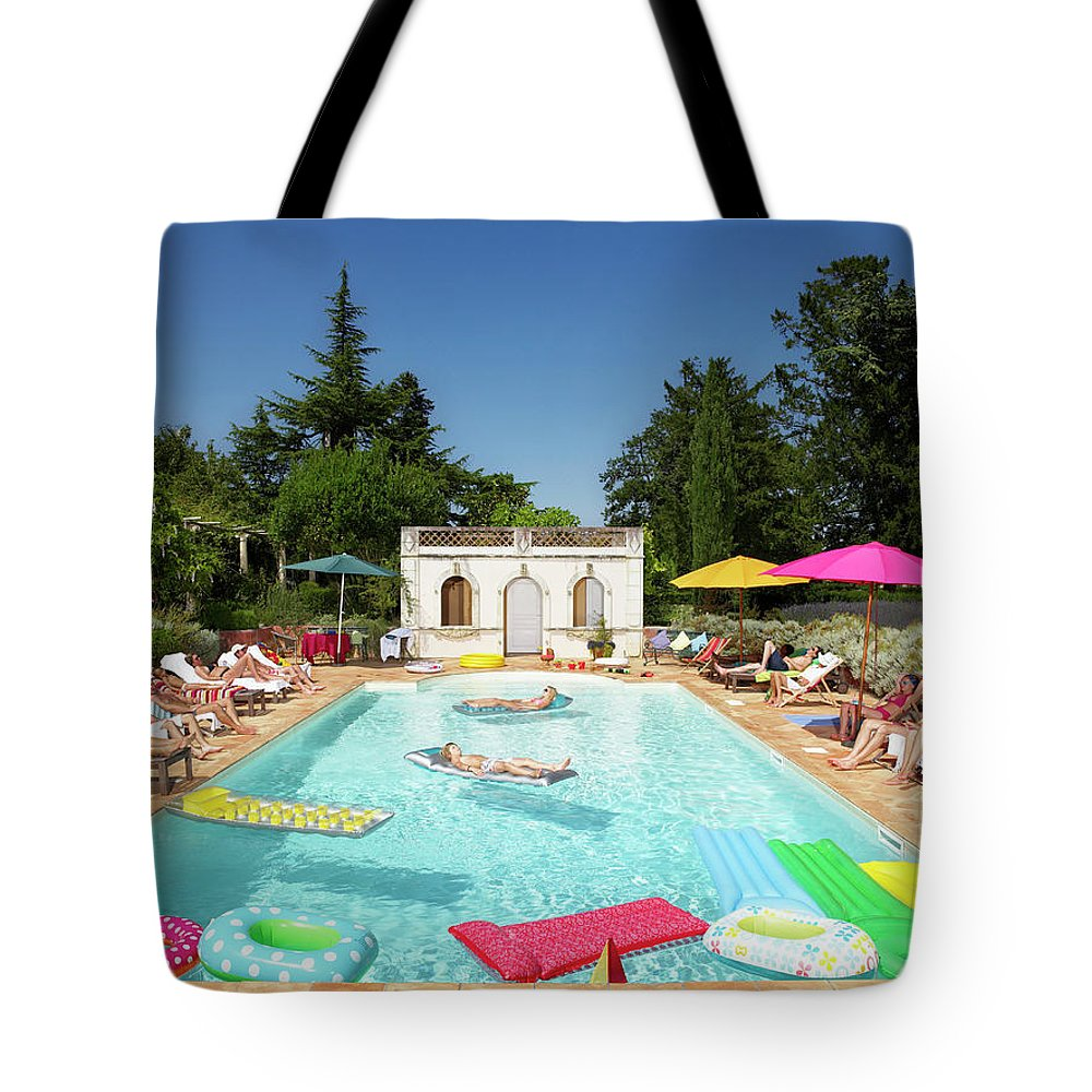 Young Men Tote Bag featuring the photograph People Enjoying Summer Around The Pool by Ghislain & Marie David De Lossy