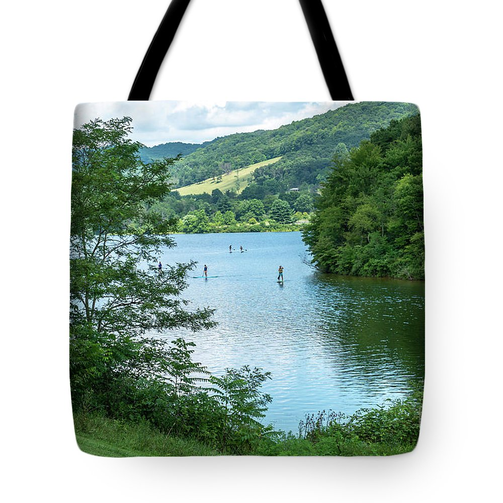 Allegany County Tote Bag featuring the photograph People Use Stand-up Paddleboards On Lake Habeeb At Rocky Gap Sta by William Kuta