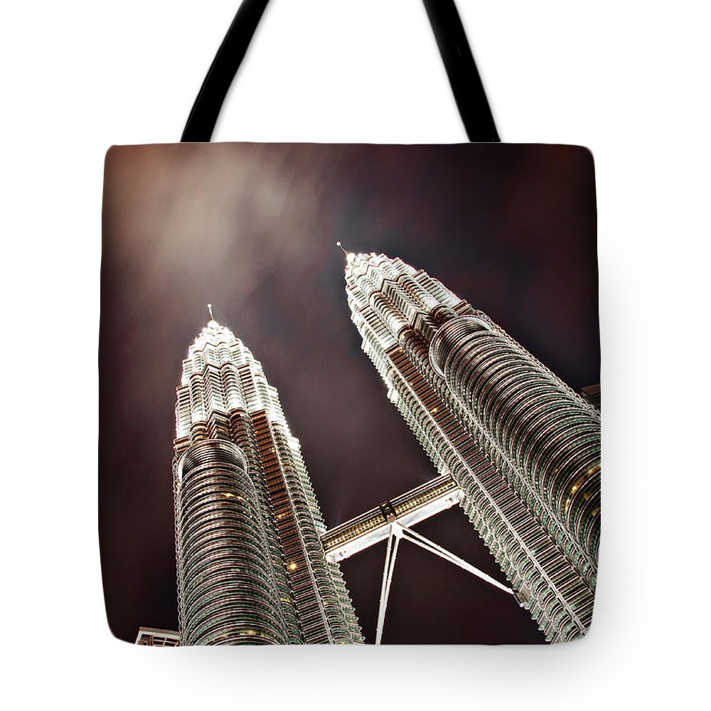 Directly Below Tote Bag featuring the photograph Petronas Towers by Smerindo schultzpax