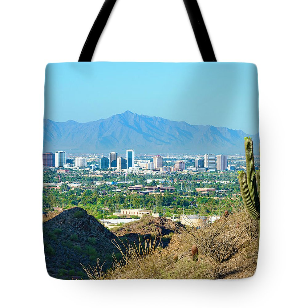 Saguaro Cactus Tote Bag featuring the photograph Phoenix Skyline Framed By Saguaro by Dszc