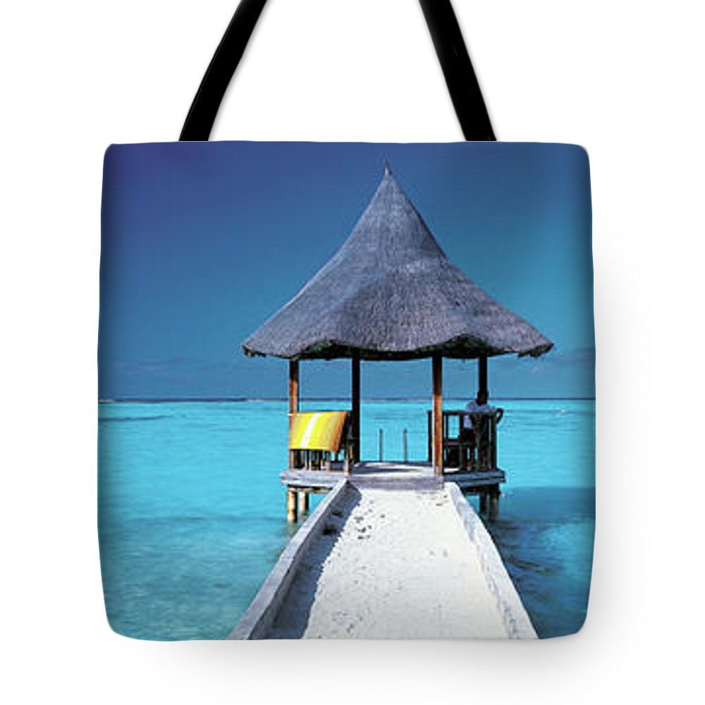Tranquility Tote Bag featuring the photograph Pier And Blue Indian Ocean, Maldives by Peter Adams