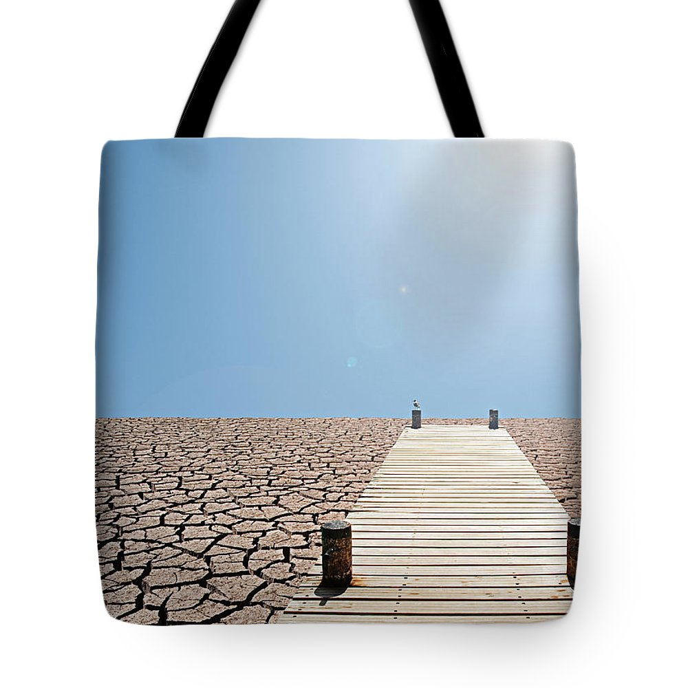 Environmental Damage Tote Bag featuring the photograph Pier Over A Dry Lake Bed by John Lund