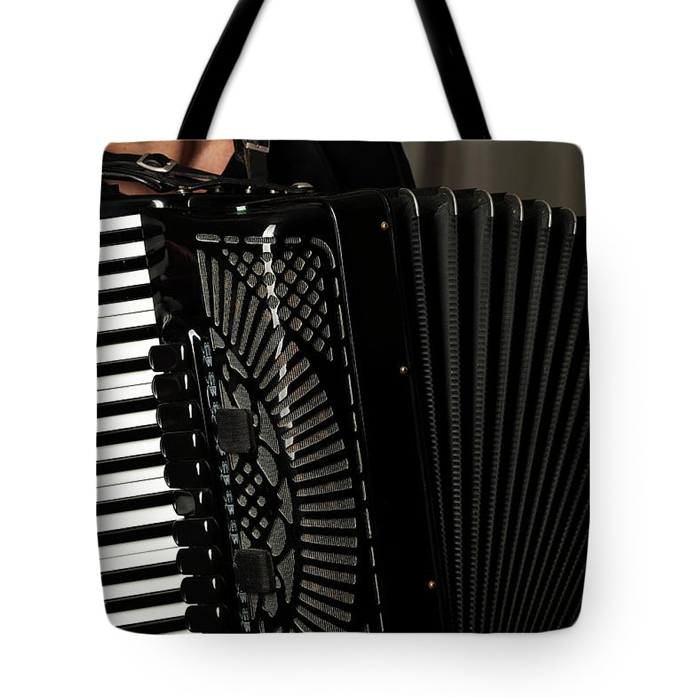 Accordion Tote Bag featuring the photograph Play The Accordion by Dejan Jekic
