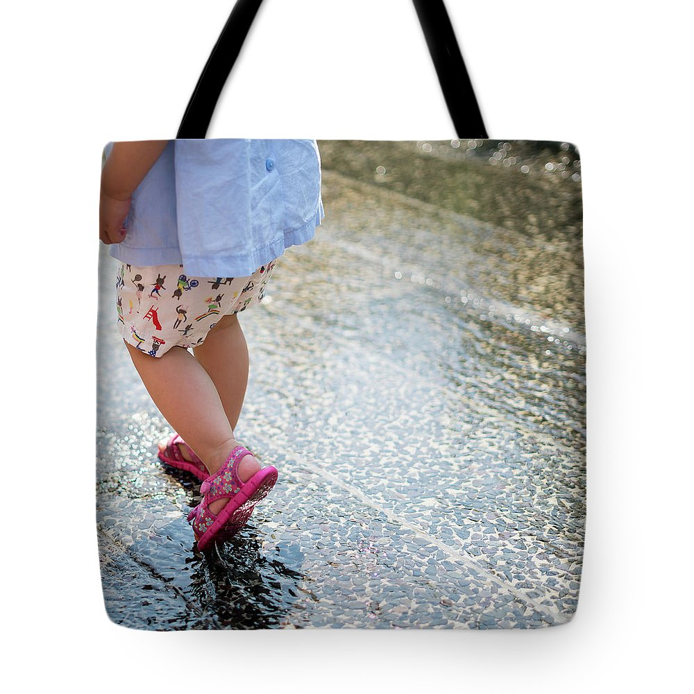 Rain Tote Bag featuring the photograph Playing In The Rain by Kaitlyn Casso