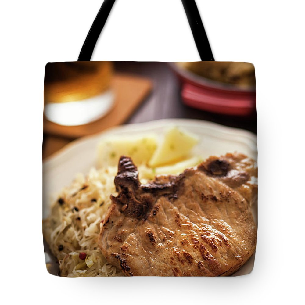 Meat Chop Tote Bag featuring the photograph Pork Chop And Sauerkraut by Gmvozd