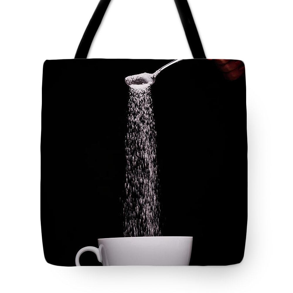 Sugar Tote Bag featuring the photograph Pouring Sugar by Stock colors
