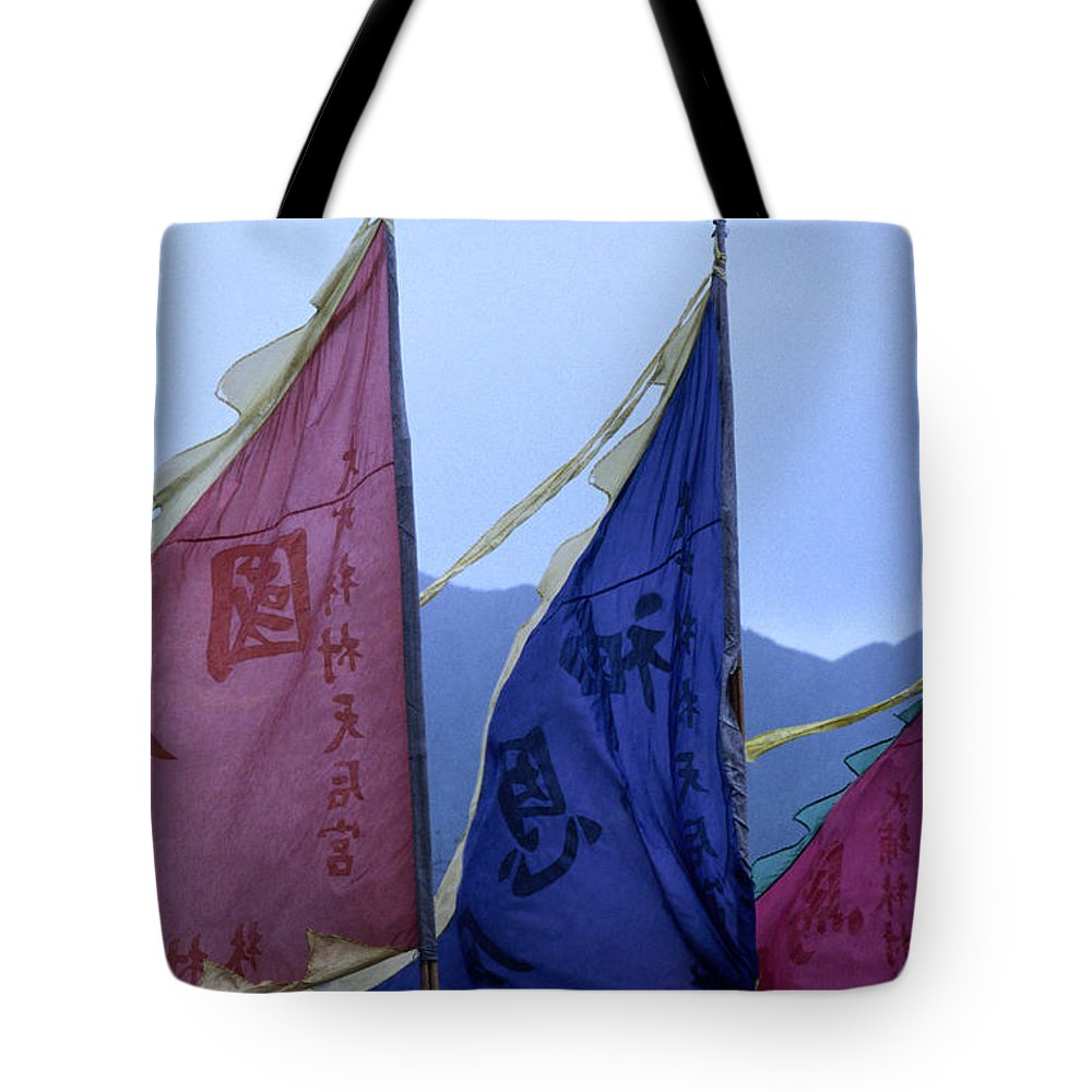Chinese Culture Tote Bag featuring the photograph Prayer Flags To The Sea Goddess Blow In by Lonely Planet