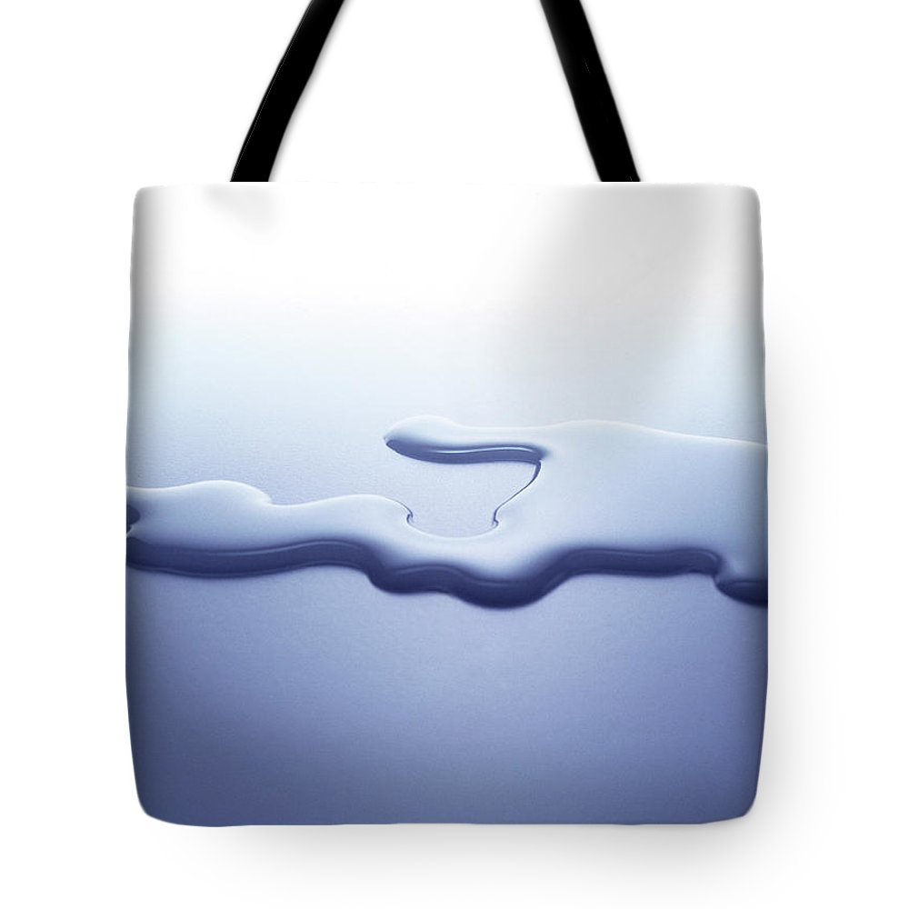 Purity Tote Bag featuring the photograph Puddle Of Water On White Surface by Nicholas Eveleigh